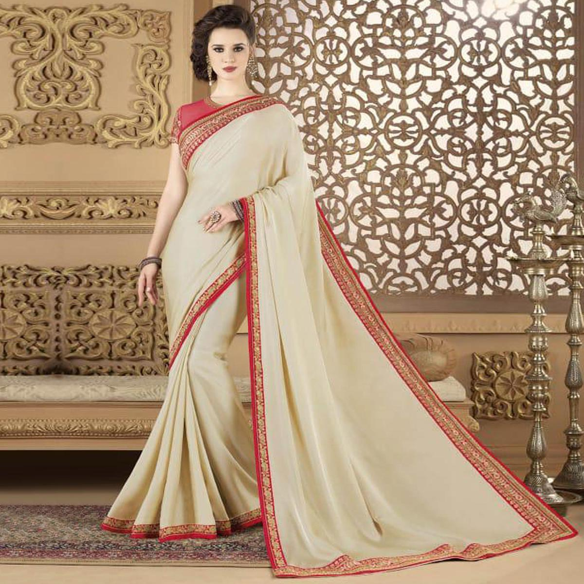 Refreshing Cream Colored Partywear Embroidered Silk Saree.