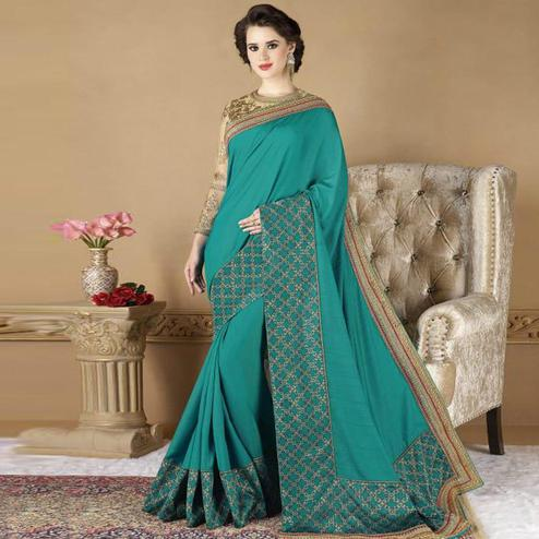 Elegant Teal Blue Colored Partywear Embroidered Silk Saree.