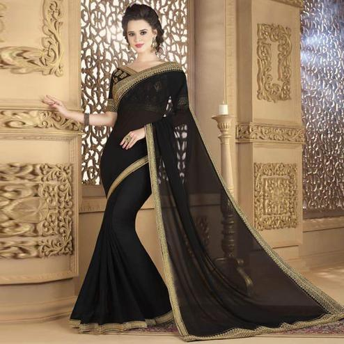 Sensational Black Colored Partywear Embroidered Art Silk Saree.