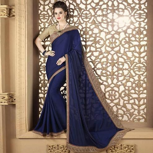 Dazzling Blue Colored Partywear Embroidered Silk Saree.