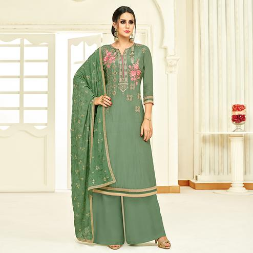 Gorgeous Green Colored Partywear Embroidered Uppada Silk Palazzo Suit