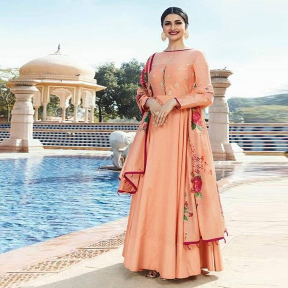 Stunning Peach Colored Partywear Embroidered Sana Silk Anarkali Suit