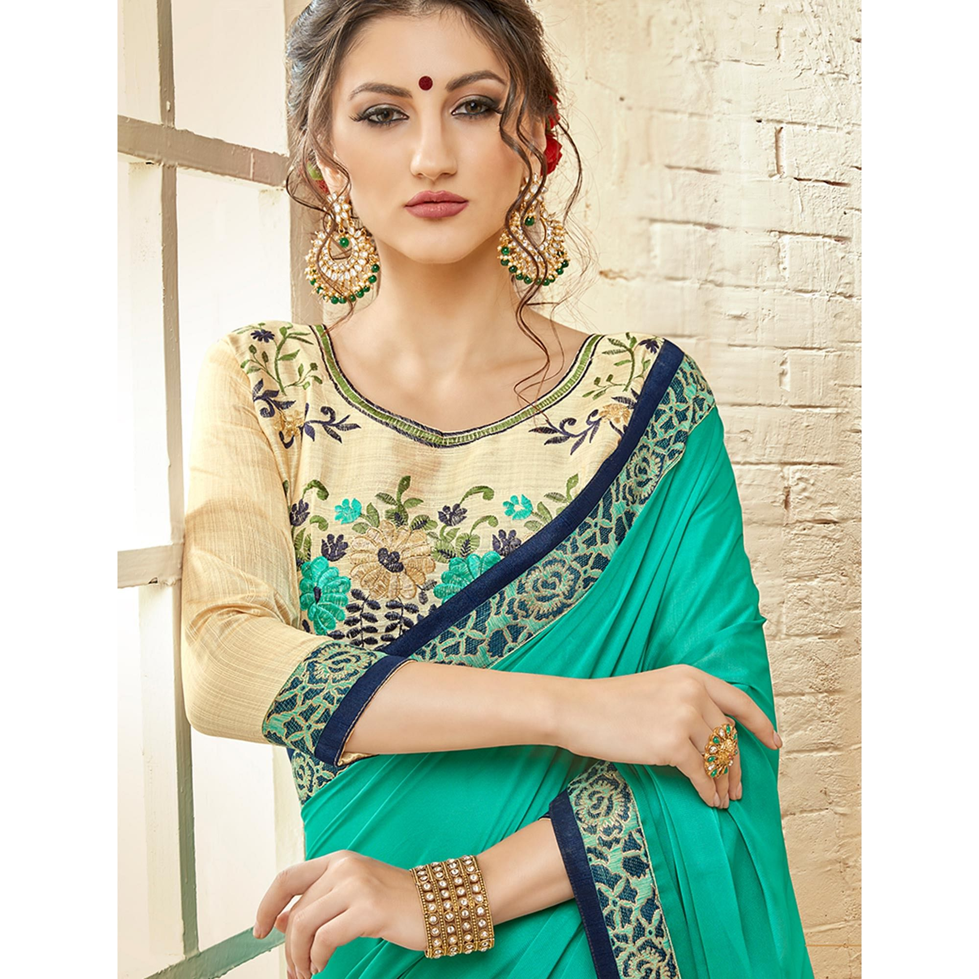 Glowing Turquoise Green Colored Partywear Embroidered Silk Georgette Saree