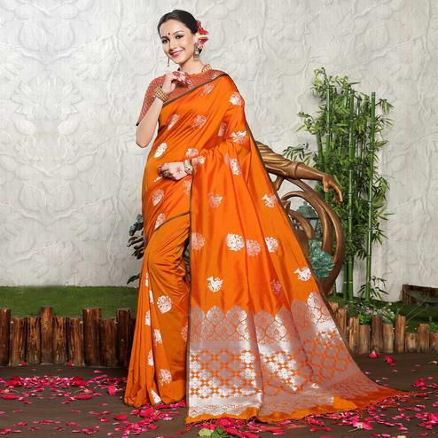 Gleaming Orange Colored Festive Wear Woven Banarasi Art Silk Saree