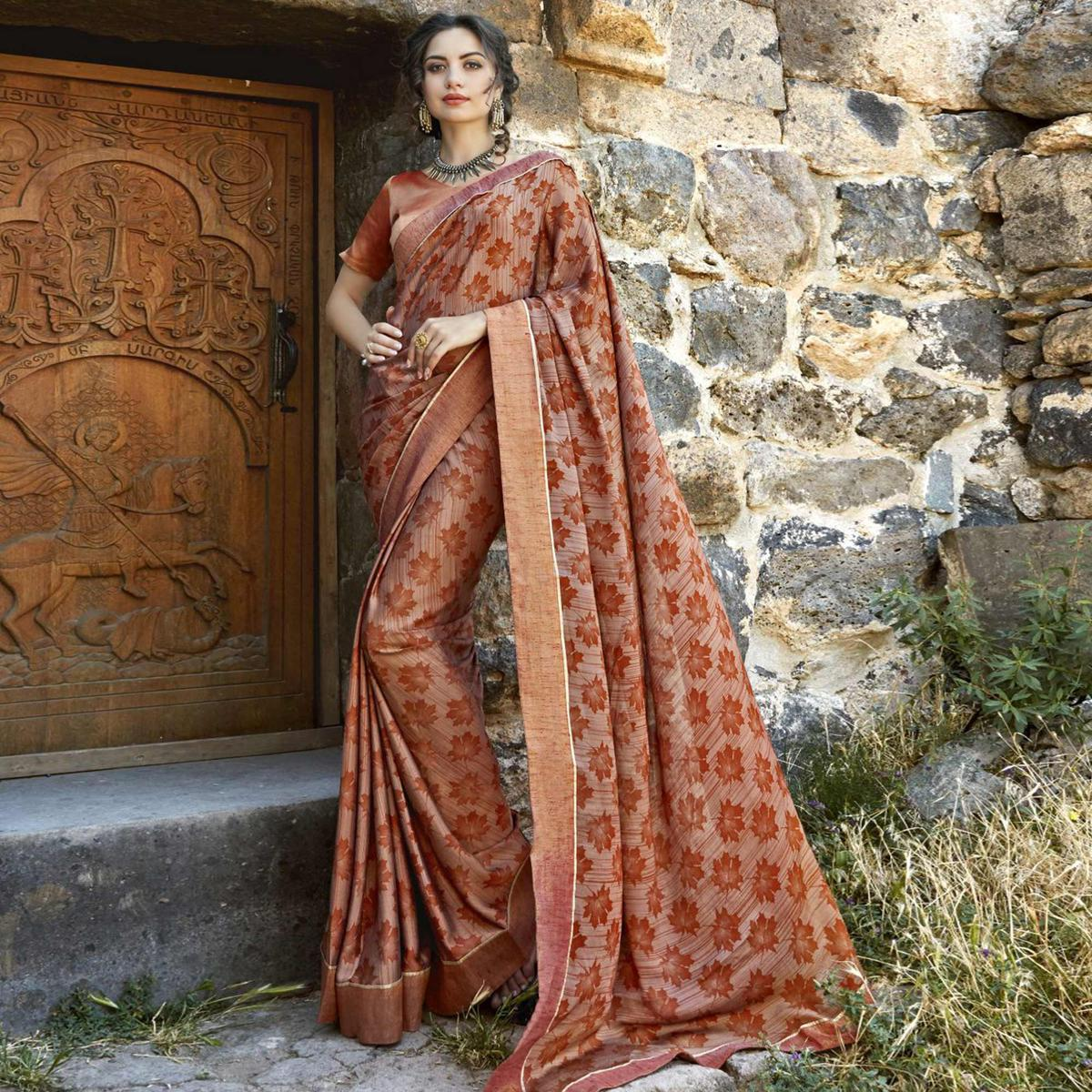 Starring Brown Colored Casual Printed Georgette Saree