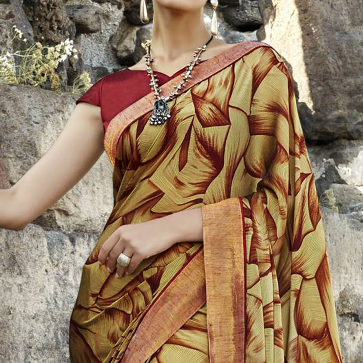 Entrancing Golden Colored Casual Printed Georgette Saree