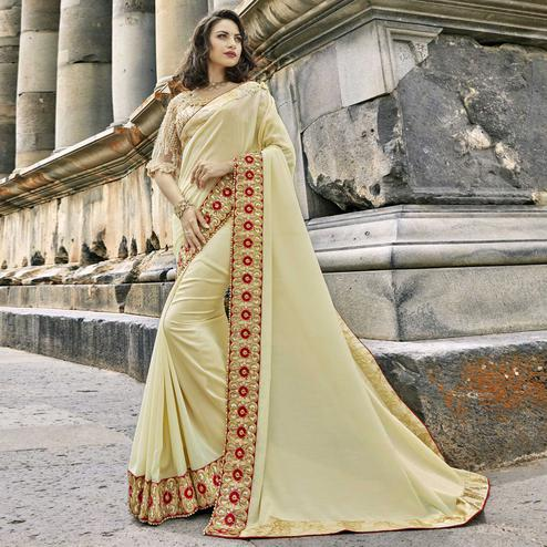 Engrossing Cream Colored Partywear Embroidered Georgette Saree
