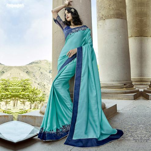Staring Aqua Blue Colored Partywear Embroidered Chanderi Silk Saree