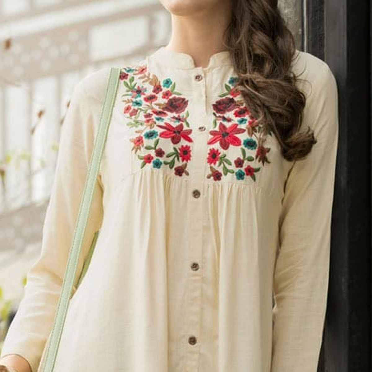 Glowing Cream Colored Embroidered Fancy Wear Rayon Top