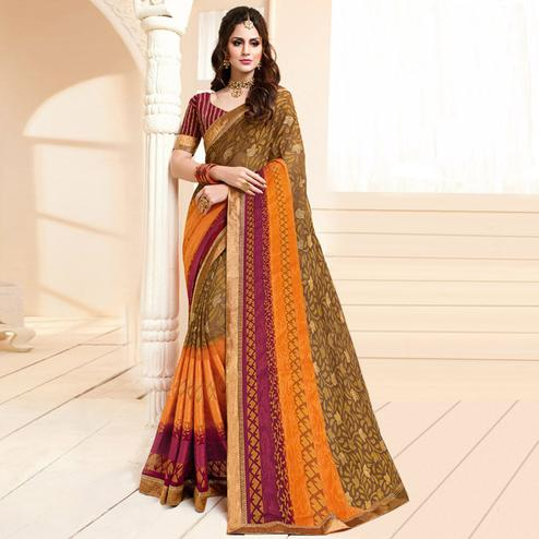 Exceptional Chiku Colored Partywear Printed Brasso Saree