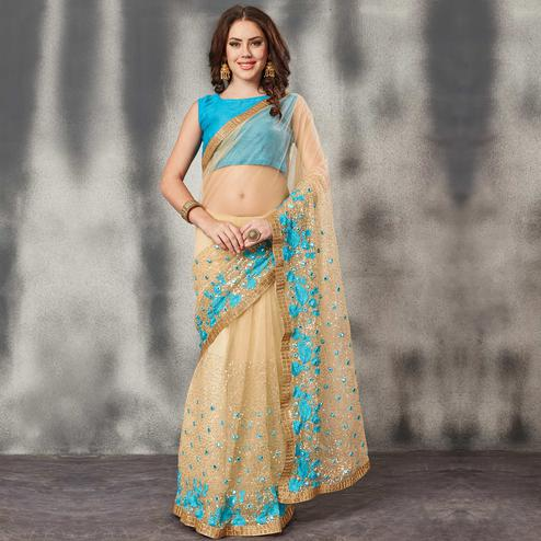 Classy Beige Sky Blue Colored Partywear Embroidered Netted Saree