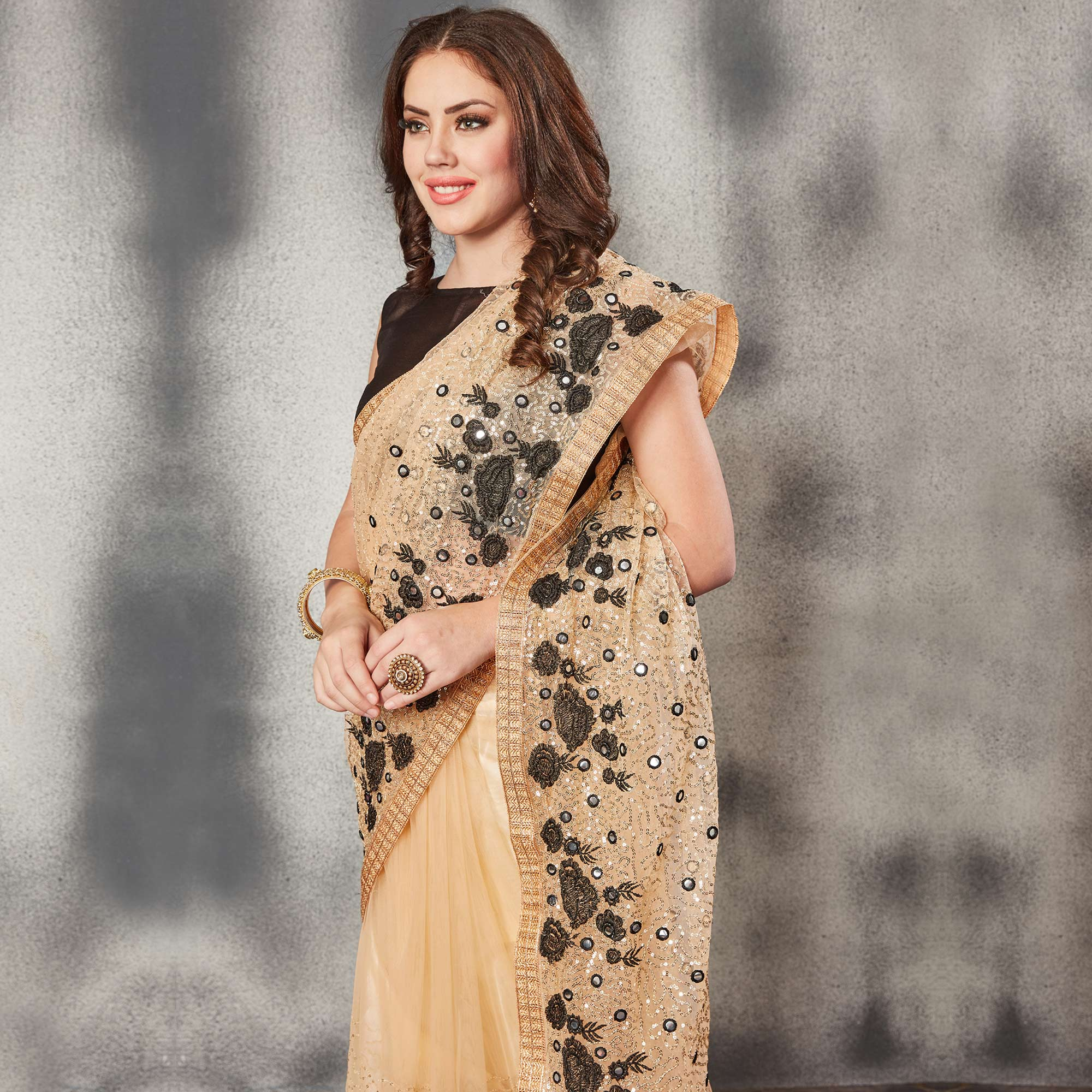 Flaunt Beige Black Colored Partywear Embroidered Netted Saree