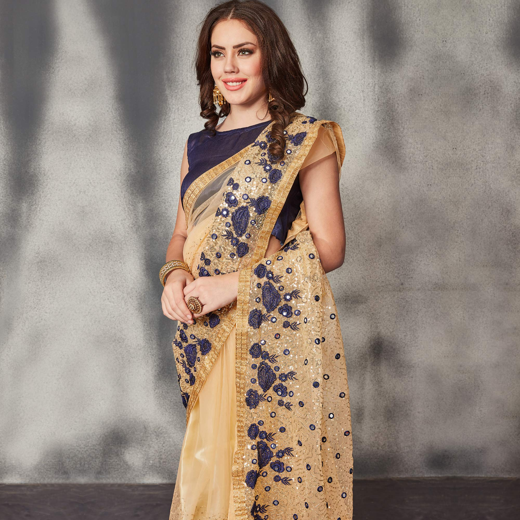 Desirable Beige Navy Blue Colored Partywear Embroidered Netted Saree
