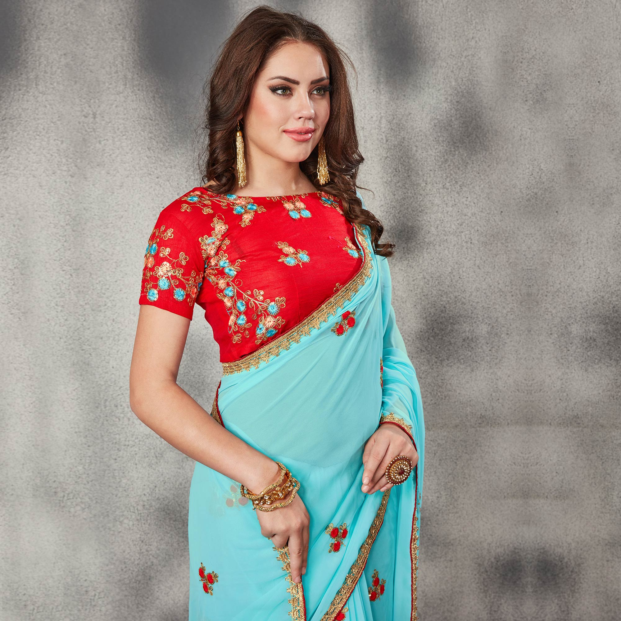Ravishing Sky Blue Colored Partywear Embroidered Georgette Saree