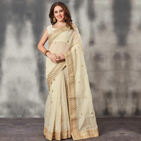 Staring Off-White Colored Partywear Embroidered Chanderi Silk Saree
