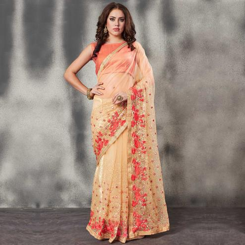Flamboyant Beige-Light Orange Colored Partywear Embroidered Netted Saree