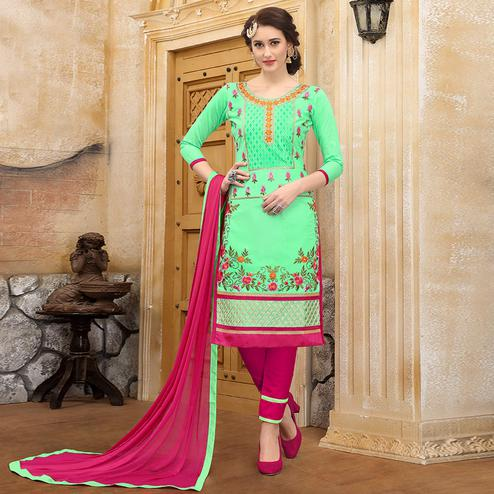Stunning Light Green Colored Party Wear Embroidered Cotton Dress Material