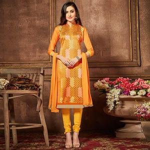 Intricate Orange Colored Party Wear Embroidered Cotton Suit