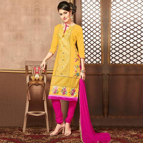 Appealing Yellow Colored Party Wear Embroidered Cotton Dress Material