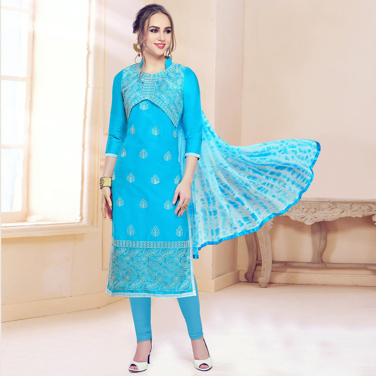 Blooming Sky Blue Colored Partywear Embroidered Cotton Dress Material