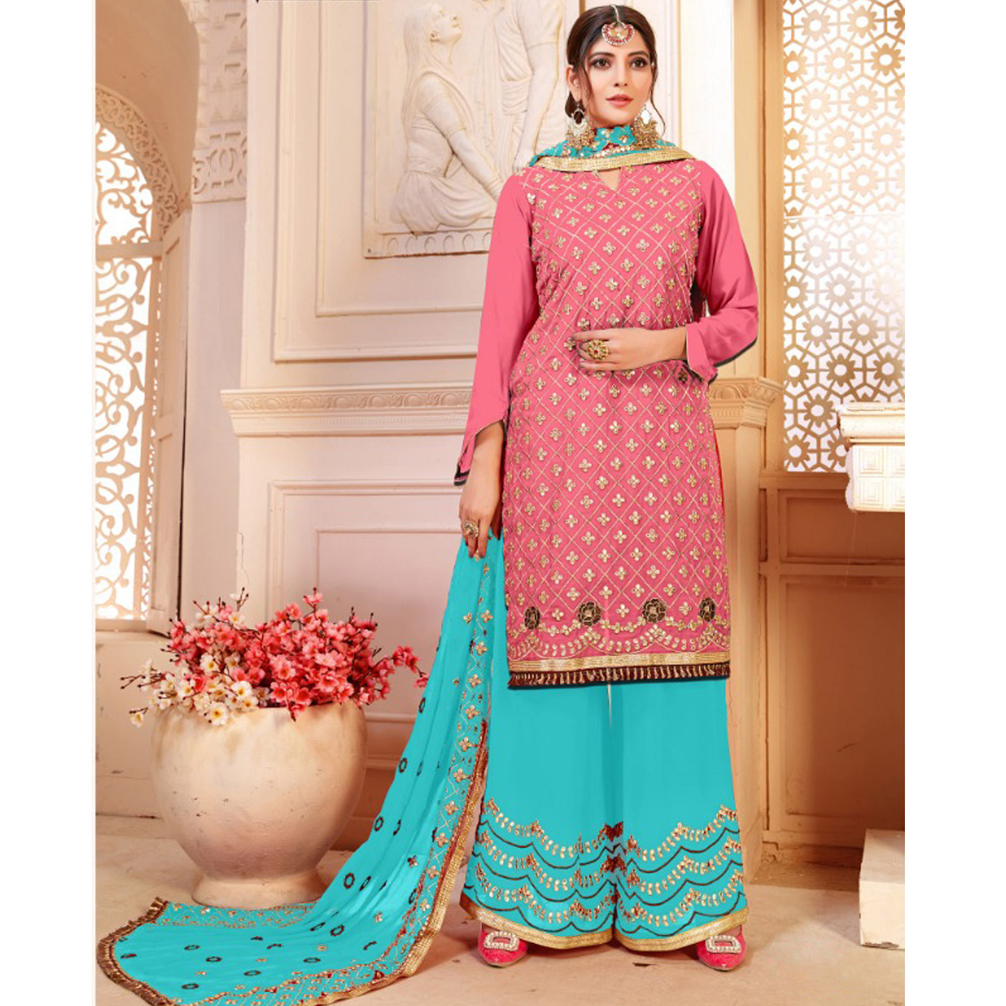 Dazzling Pink Colored Party Wear Embroidered Georgette Palazzo Suit