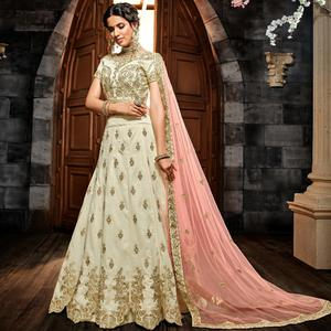 Captivating Off White Colored Party Wear Embroidered Silk Lehenga Choli