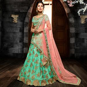 Glowing Turquoise Green Colored Party Wear Embroidered Silk Lehenga Choli