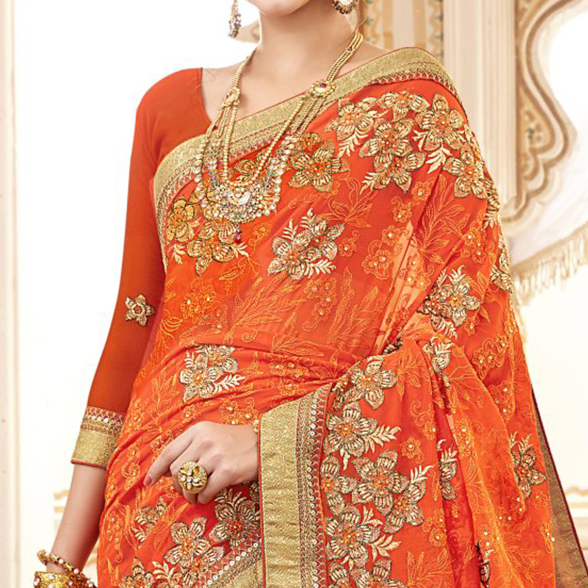 Ravishing Orange Colored Partywear Embroidered Faux Georgette Saree