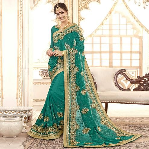 Staring Turquoise Green Colored Partywear Embroidered Faux Georgette Saree