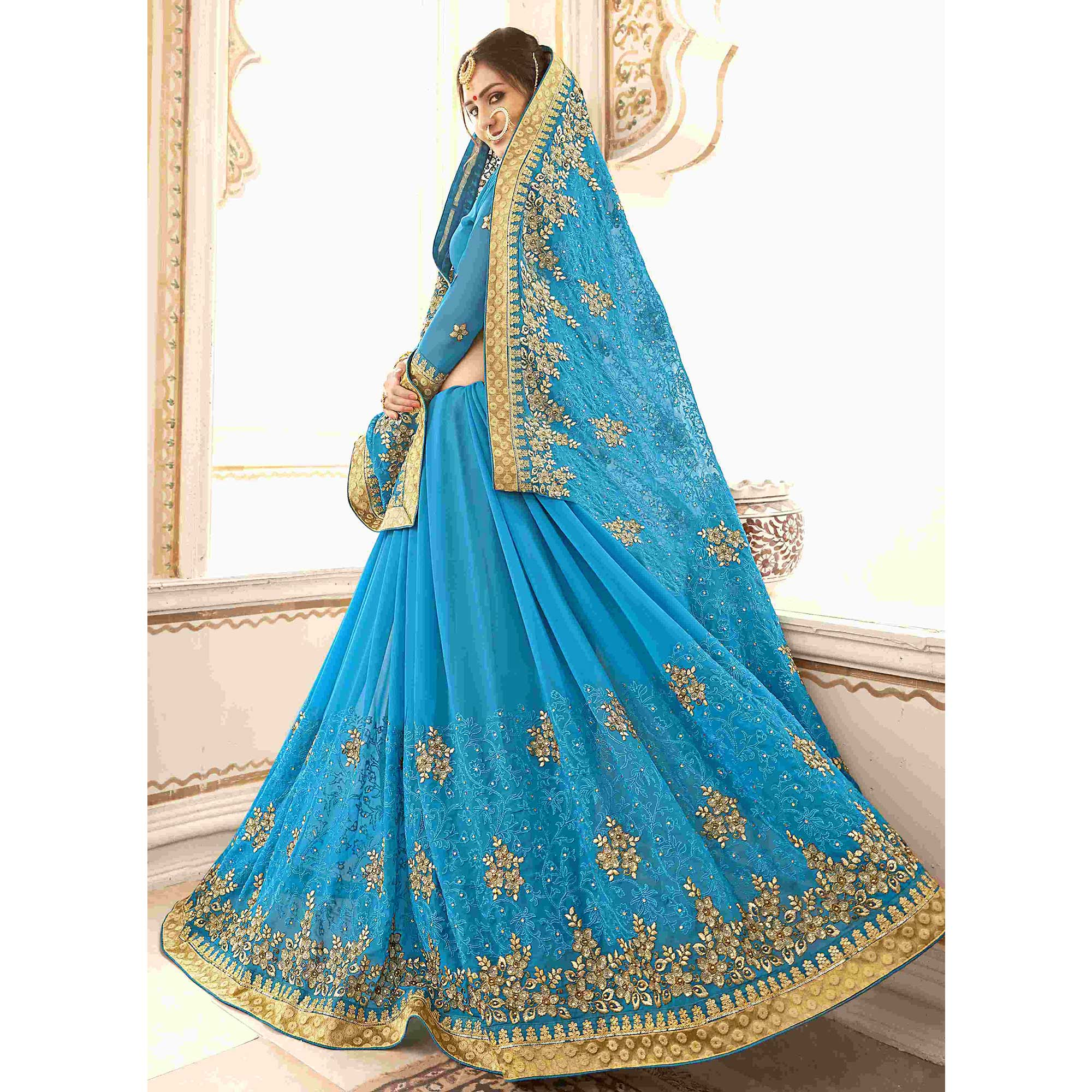Engrossing Sky Blue Colored Partywear Embroidered Faux Georgette Saree