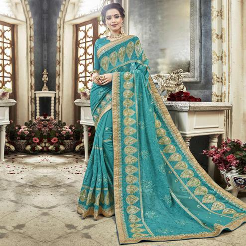 Entrancing Sky Blue Colored Partywear Embroidered Faux Georgette Saree