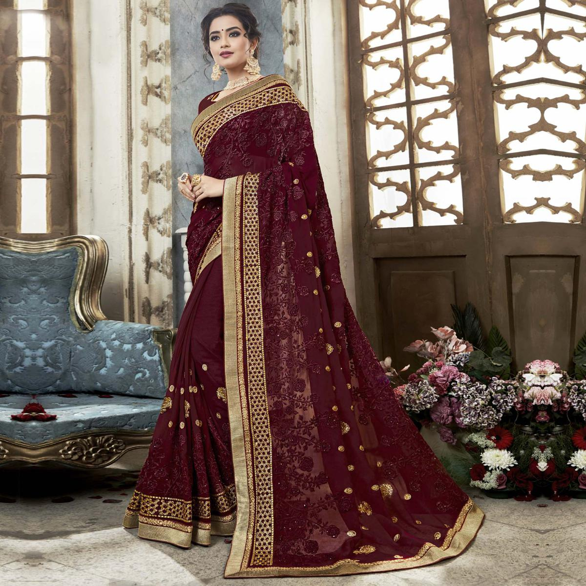 Surpassing Wine Colored Partywear Embroidered Faux Georgette Saree