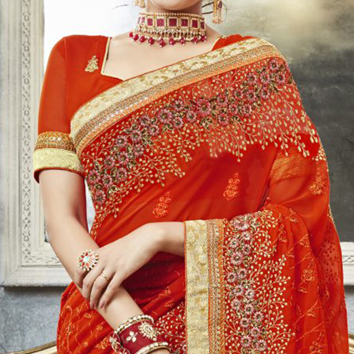 Starring Orange Colored Partywear Embroidered Faux Georgette Saree