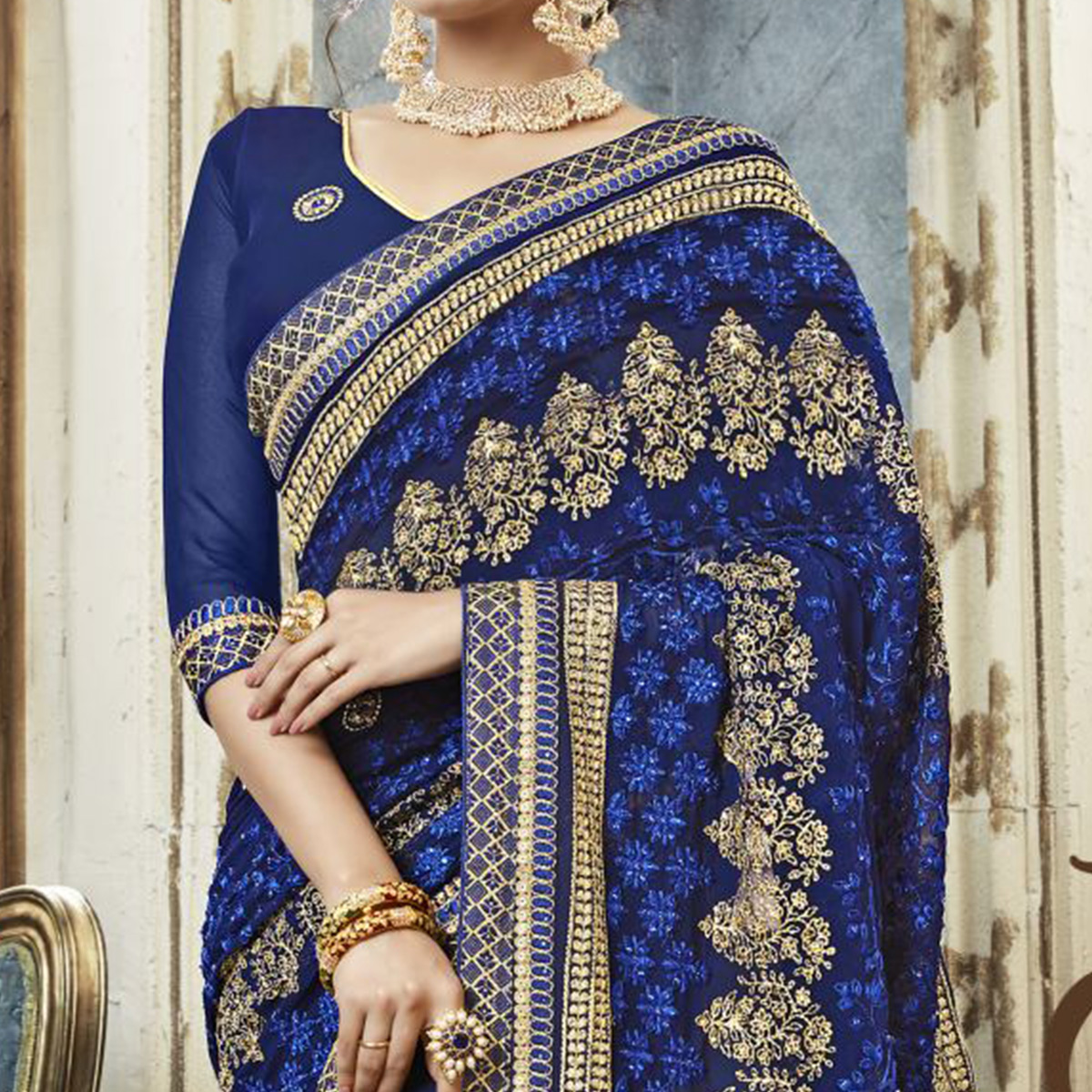 Excellent Navy Blue Colored Partywear Embroidered Faux Georgette Saree
