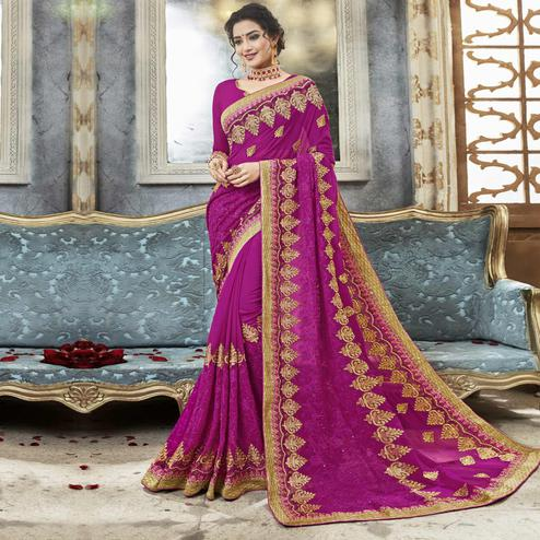 Gleaming Violet Colored Partywear Embroidered Faux Georgette Saree