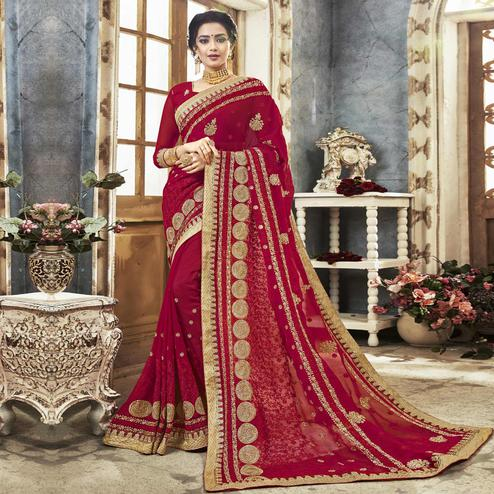 Arresting Deep Pink Colored Partywear Embroidered Faux Georgette Saree