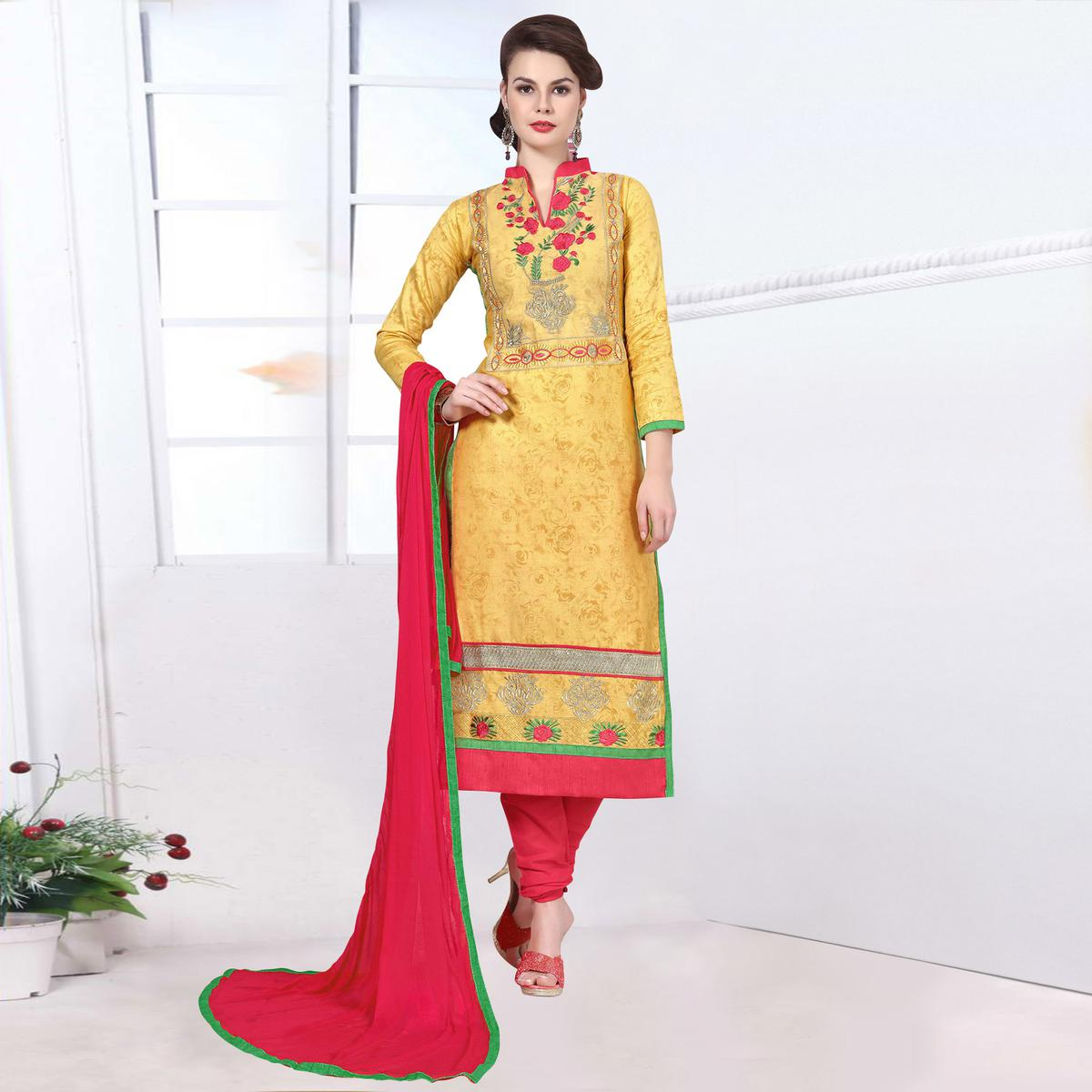 Staring Yellow Colored Party Wear Embroidered Cotton Dress Material