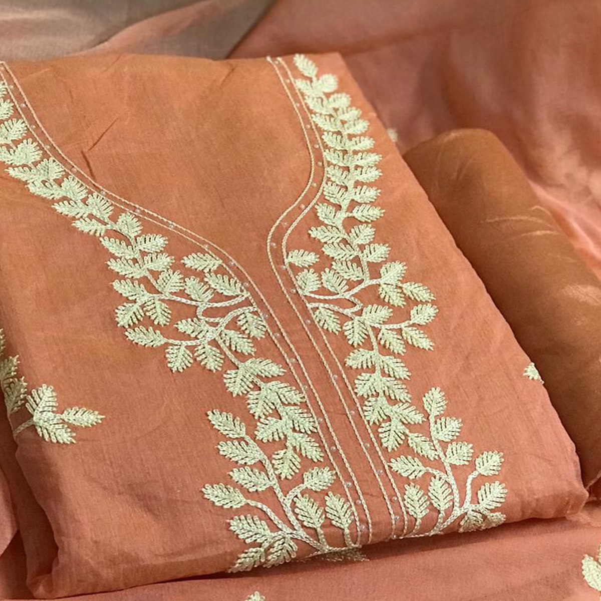 Adorable Peach Colored Partywear Embroidered Chanderi Cotton Dress Material