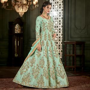 Fabulous Aqua Green Colored Partywear Embroidered Mulberry Silk Anarkali Suit