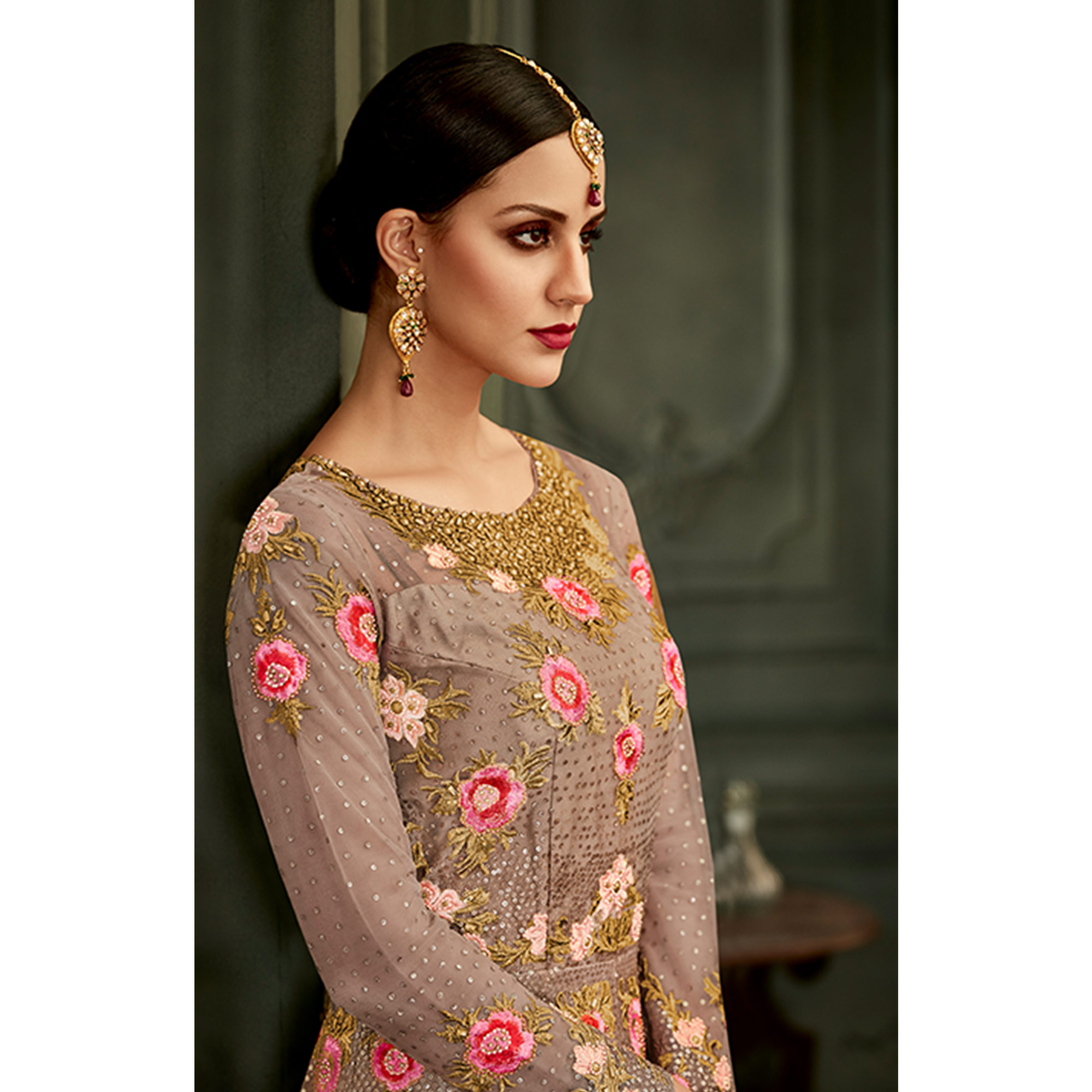 Stunning Light Mauve Colored Partywear Embroidered Netted Anarkali Suit