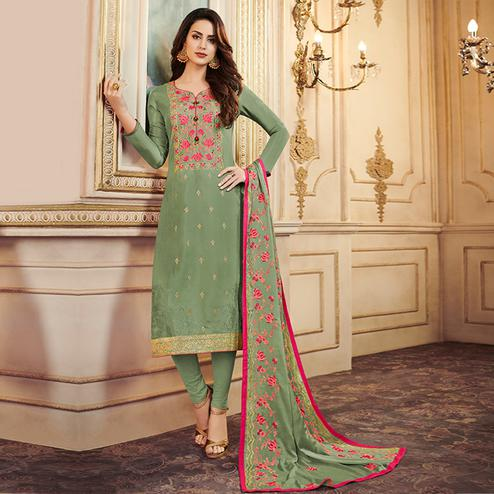 Stunning Pastel Olive Green Colored Partywear Embroidered Uppada Silk Suit