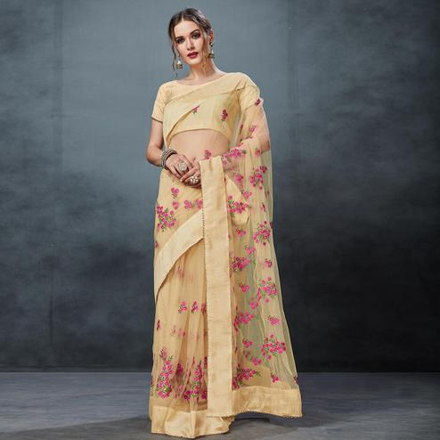 Marvellous Beige Colored Partywear Embroidered Netted Saree