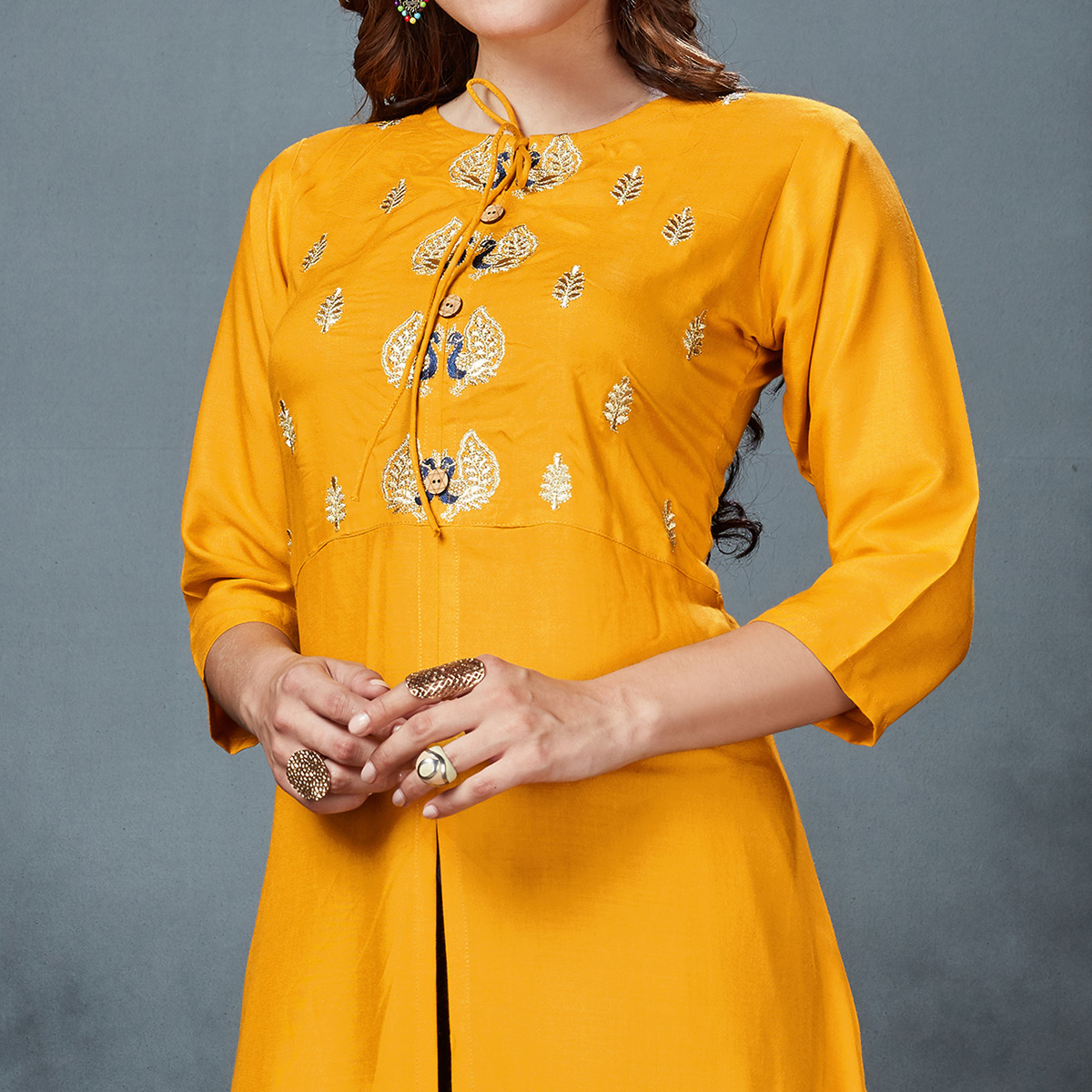 Blooming Yellow Colored Partywear Embroidered Rayon Kurti