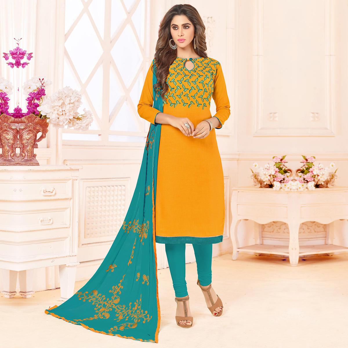 Pleasant Yellow Colored Embroidered Cotton Dress Material