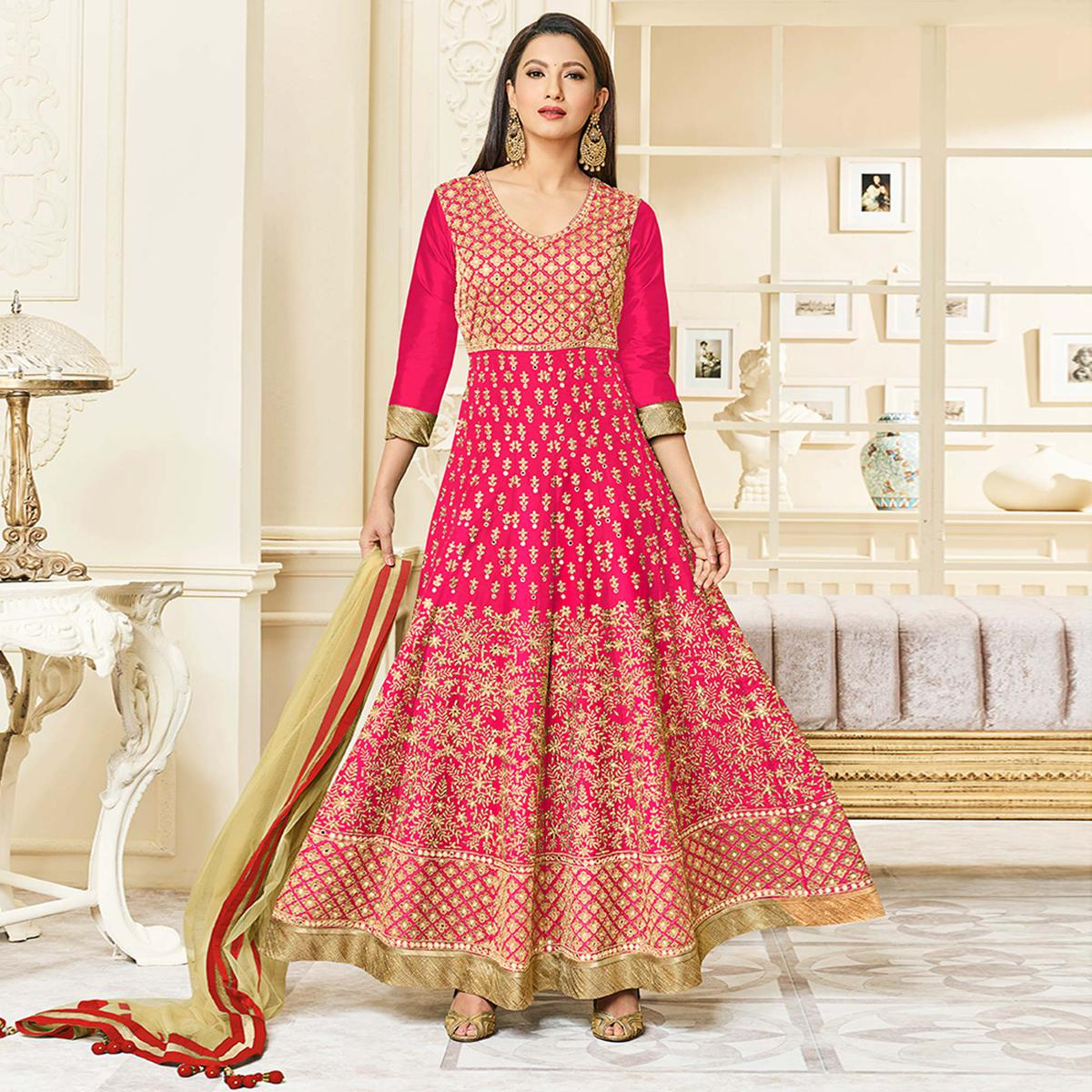 Staring Deep Pink Colored Party Wear Embroidered Mulberry Silk Anarkali Suit