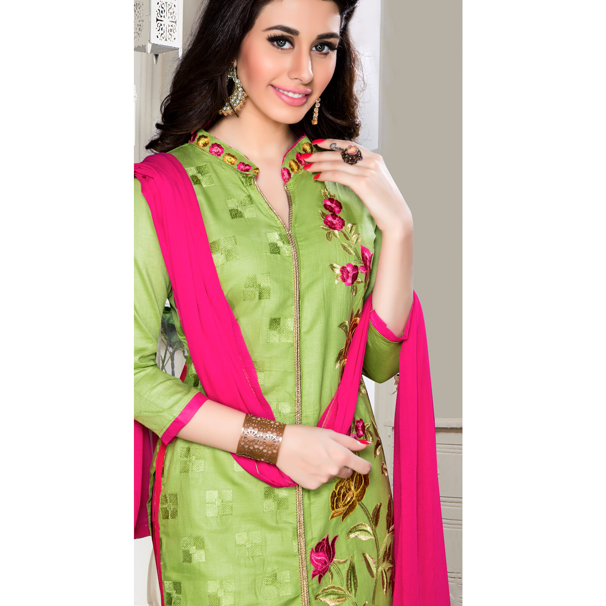 Exotic Green Colored Party Wear Embroidered Cotton Dress Material