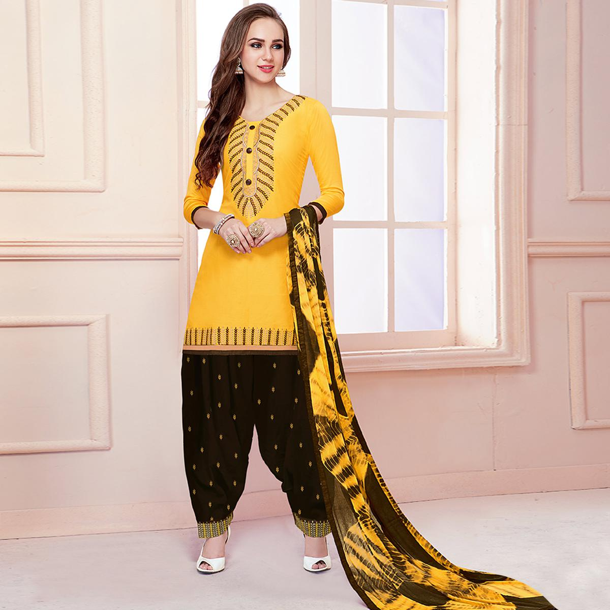 Dazzling Yellow Colored Partywear Embroidered Cotton Patiala Dress Material