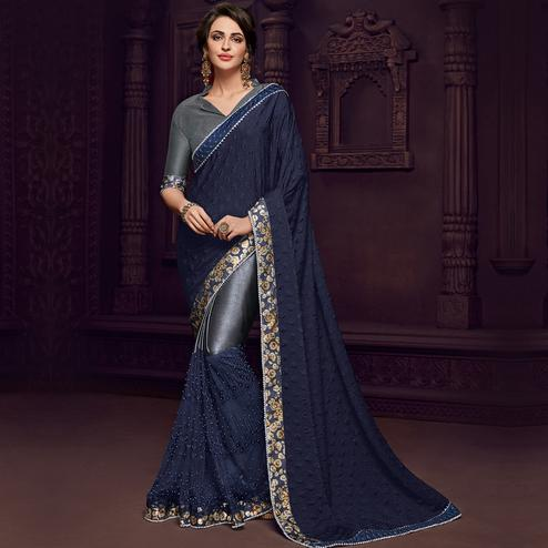 Entrancing Violet Colored Party Wear Embroidered Fancy Art Silk Saree