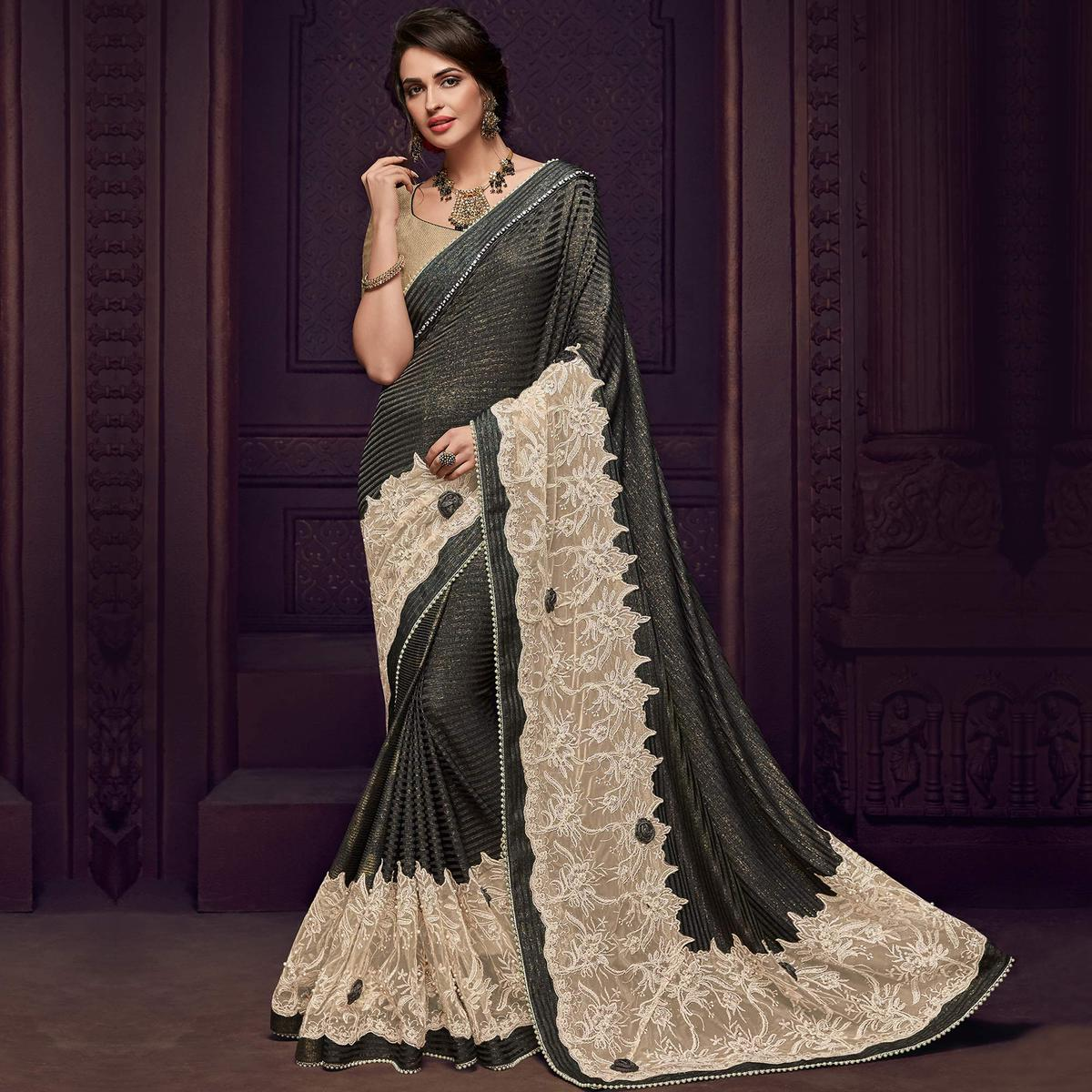 Engrossing Black And Beige Colored Party Wear Embroidered Fancy Art Silk Saree