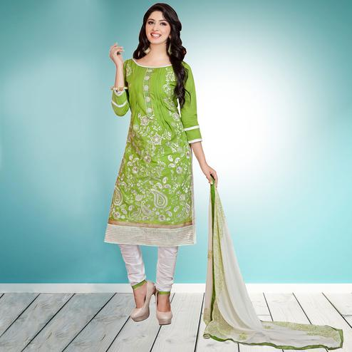 Pleasant Green Colored Partywear Embroidered Cambric Cotton Dress Material